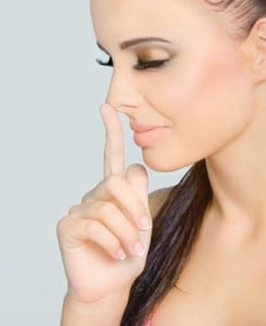 woman touching nose