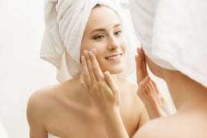Woman Moisturizing Face