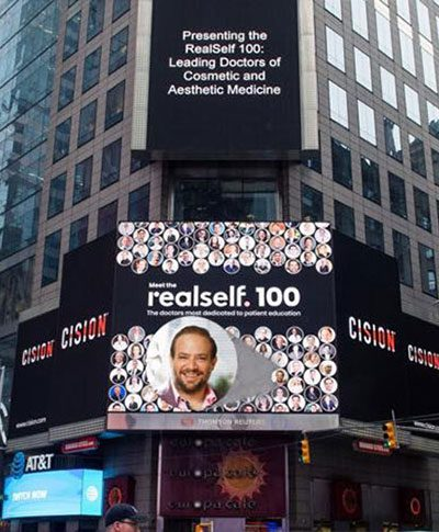 Dr Frank Agullo RealSelf 100: Leading Doctors of Cosmetic and Aesthetic Medicine - Billboard sign announcement in Time Square, NYC
