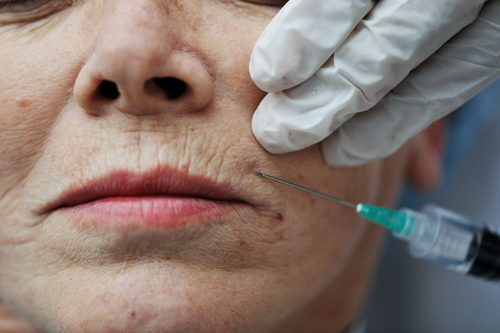 Senior woman getting skin care injection -img-blog