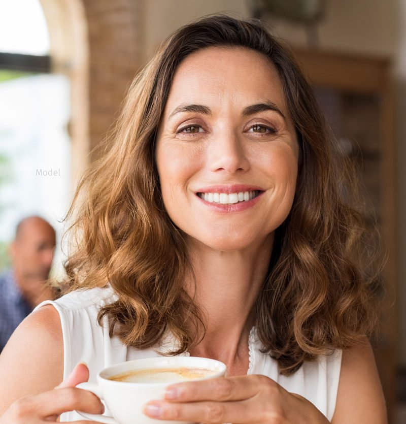 Beautiful brunette woman with a cup of coffee.