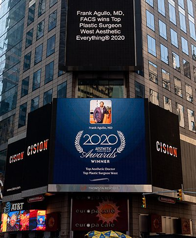 Dr Frank Agullo Wins Top Plastic Surgeon West Aesthetic Everything® 2020 - Billboard sign announcement in Time Square, NYC